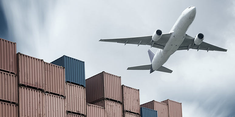 Airplane_flying_over_containers_big
